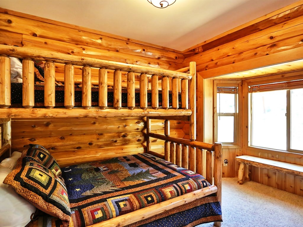 This bedroom includes a delightful bunk bed with enough room to sleep three people.