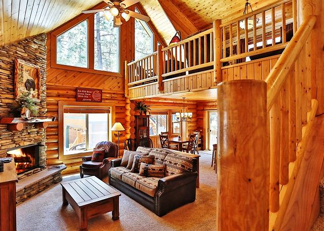 Big Bear is known for its cold evenings and nights, which makes this home such a wonderful respite if you're from a particularly hot region. Beautiful wooden interiors, comfy seating, the cool night air and a roaring fire make this room the perfect place