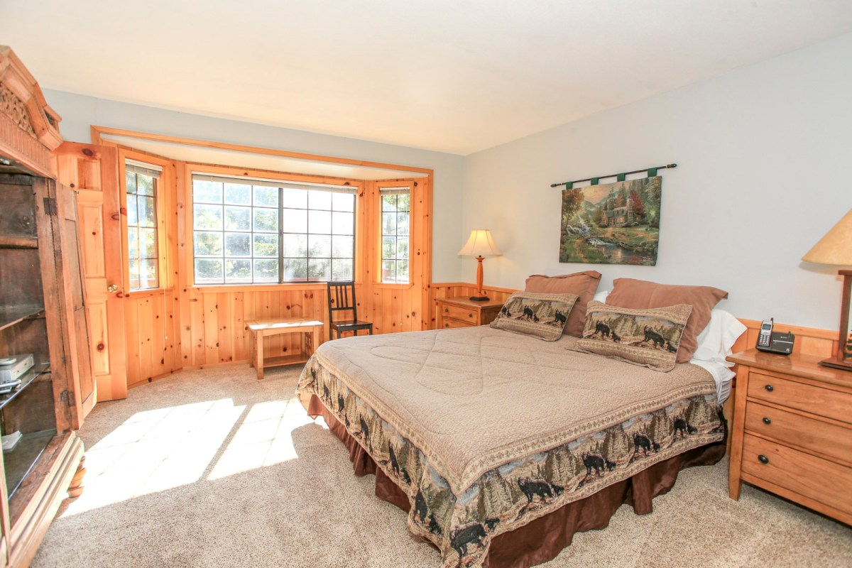 Breath in the mountain air and sleep soundly in this comfy King sized bed in this beautiful cabin Master Bedroom.