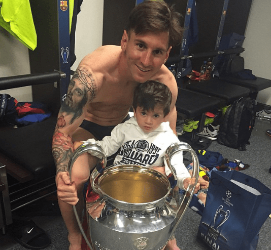 Messi with his little messi and the trophy