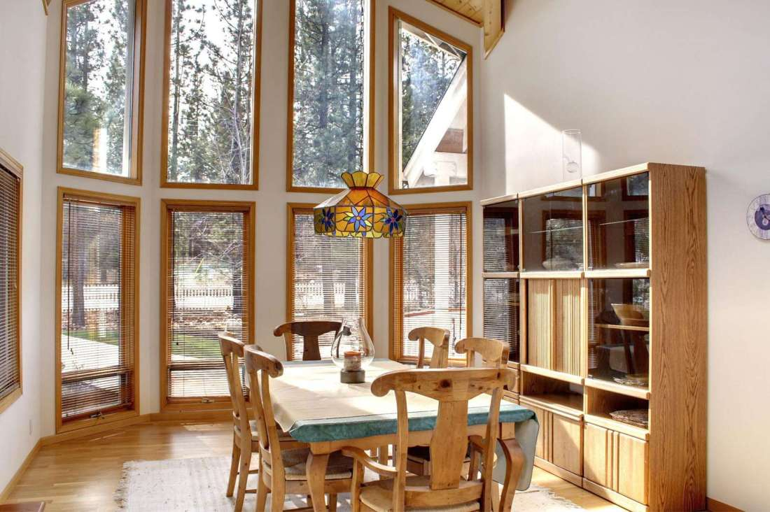 Dining room with views of garden out the two story windows
