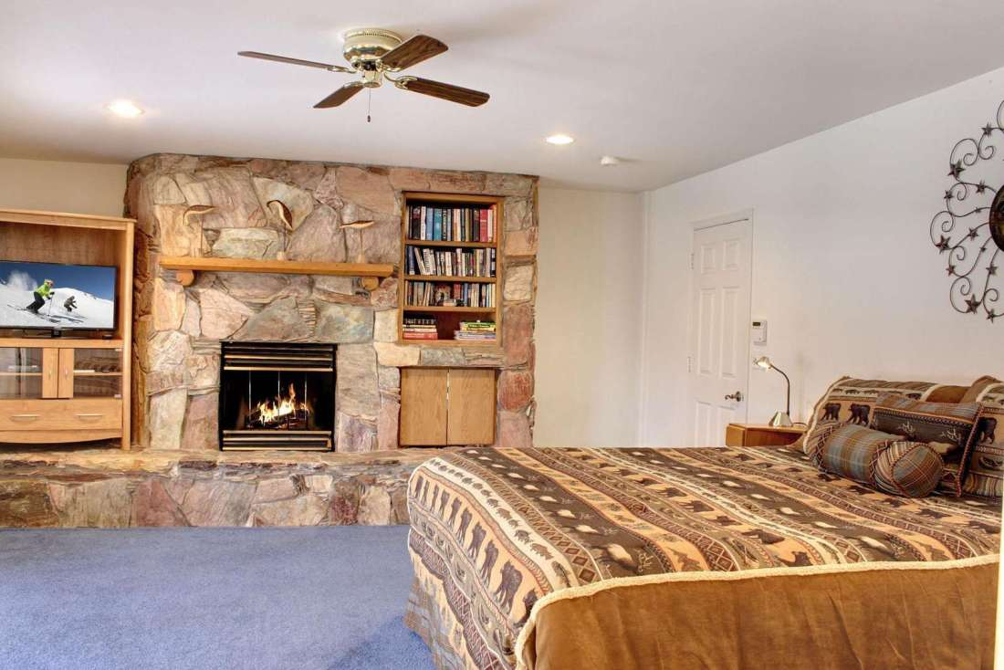 Master bedroom with fireplace and views to lake
