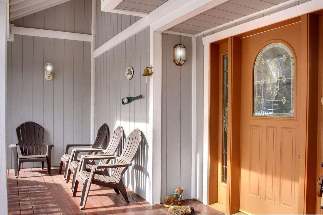 Wrap around front porch has nooks and seating for relaxing outdoors