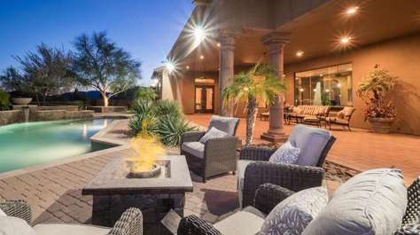 Large Outdoor Entertainment Area Next to Pool