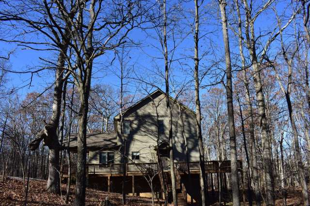 View of this very large home - winter view - wrap around deck