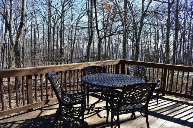 One set of deck table and chairs