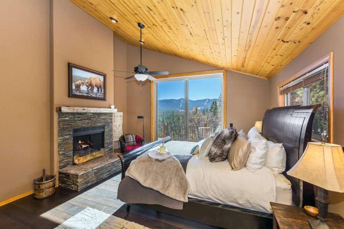 Master Bedroom has king bed and sliding door to view decks