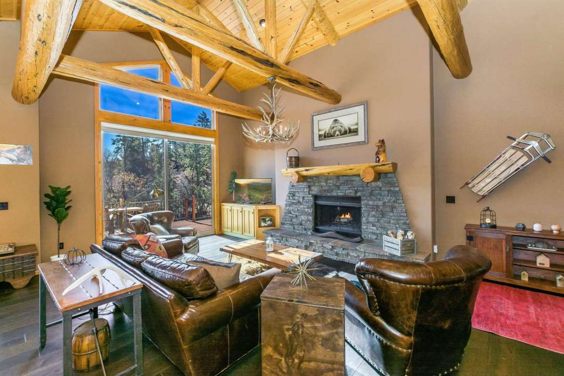 Start a fire in the wood burning fireplace while watching the snow fall from the floor to ceiling windows