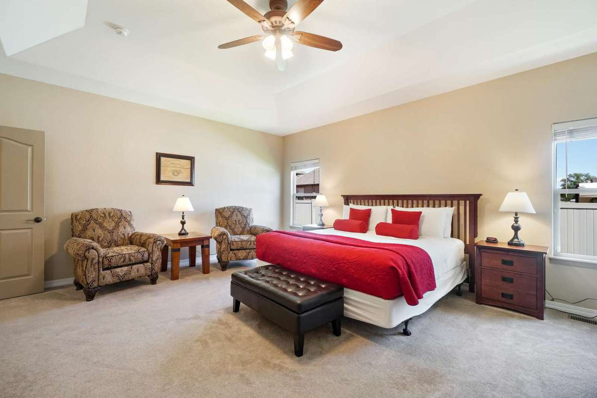 Comfy king size bedroom has a sitting area
