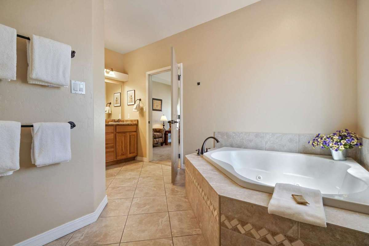 This beautiful Jacuzzi tub is located in the master bedroom