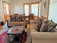 Living room has plenty of space to sit with two comfortable couches and a sitting area thumb