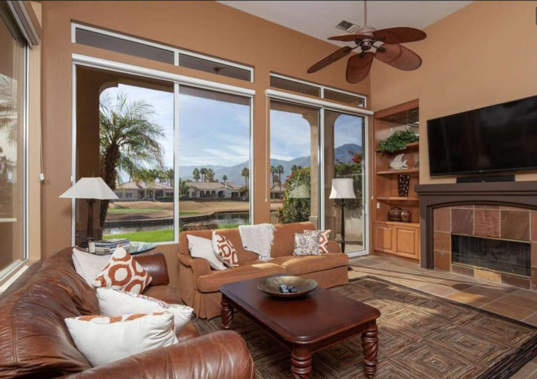 Living Room with HD TV and 10 ft glass sliding doors