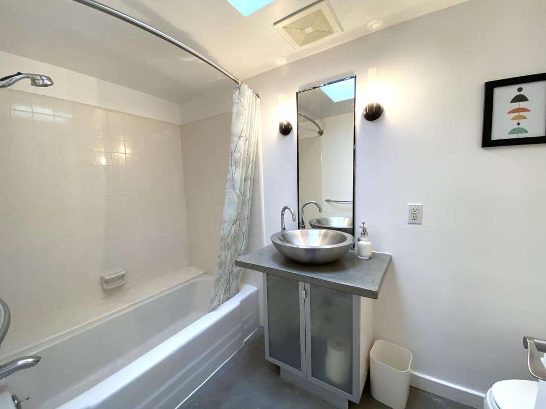 Shared bathroom with shower tub