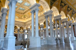 A partial view of the ceiling and second-floor marble columns.