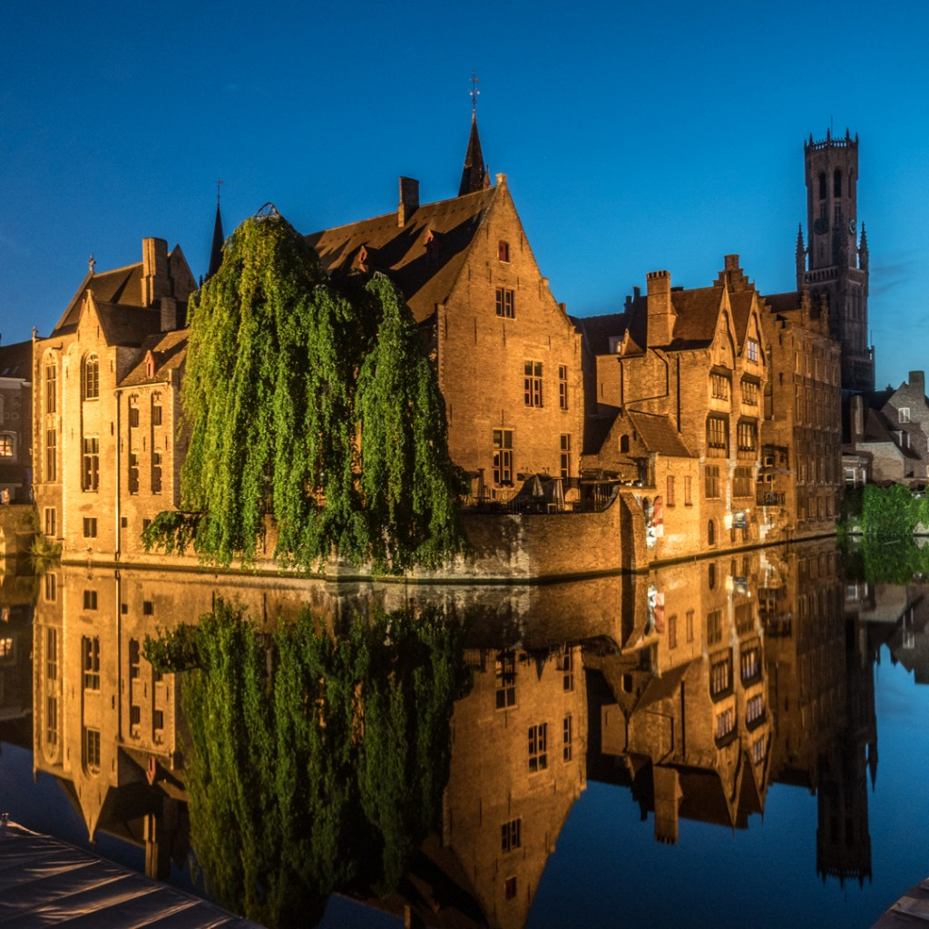 One of the most photographed corners of Bruges along the canals
