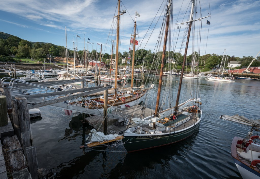 Sailboats stand ready for cruising and fishing in the waters outside of Camden, ME