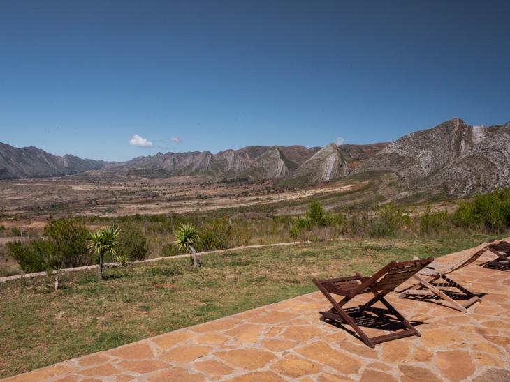 Two deckchairs on a terrace overlooking the Torotoro landscape, Bolivia