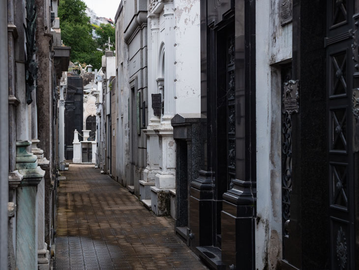An alleyway of huge mausoleums in Recoleta Cementerio, Buenos Aires, Argentina