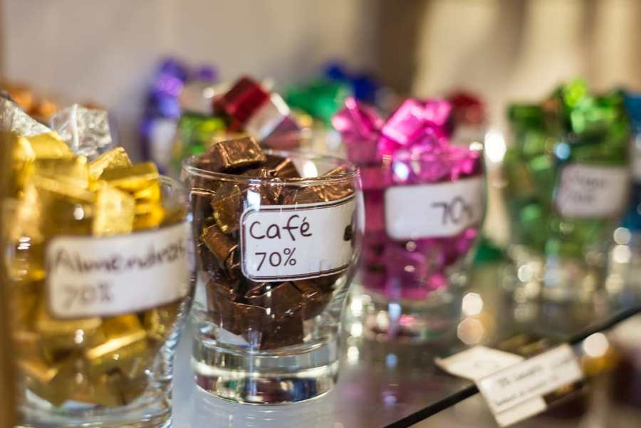 Cusco's chocolate museum - A display of glass cups holding various chocolates from the ChocoMuseo