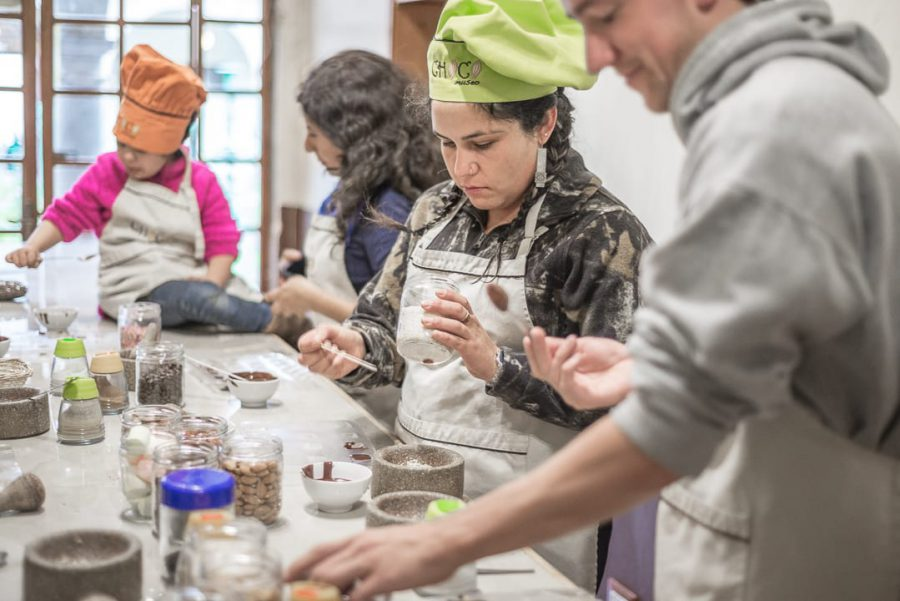Cusco's chocolate museum - Chocolate workshop participants in action at the ChocoMuseo