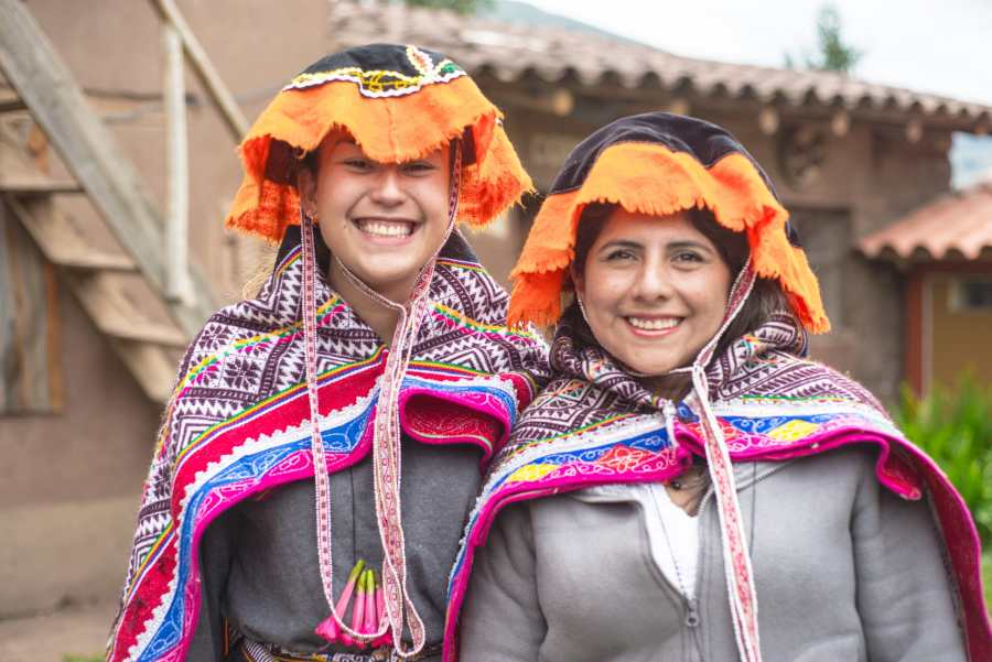 Peruvian textile weaving - Dressing in traditional costume.
