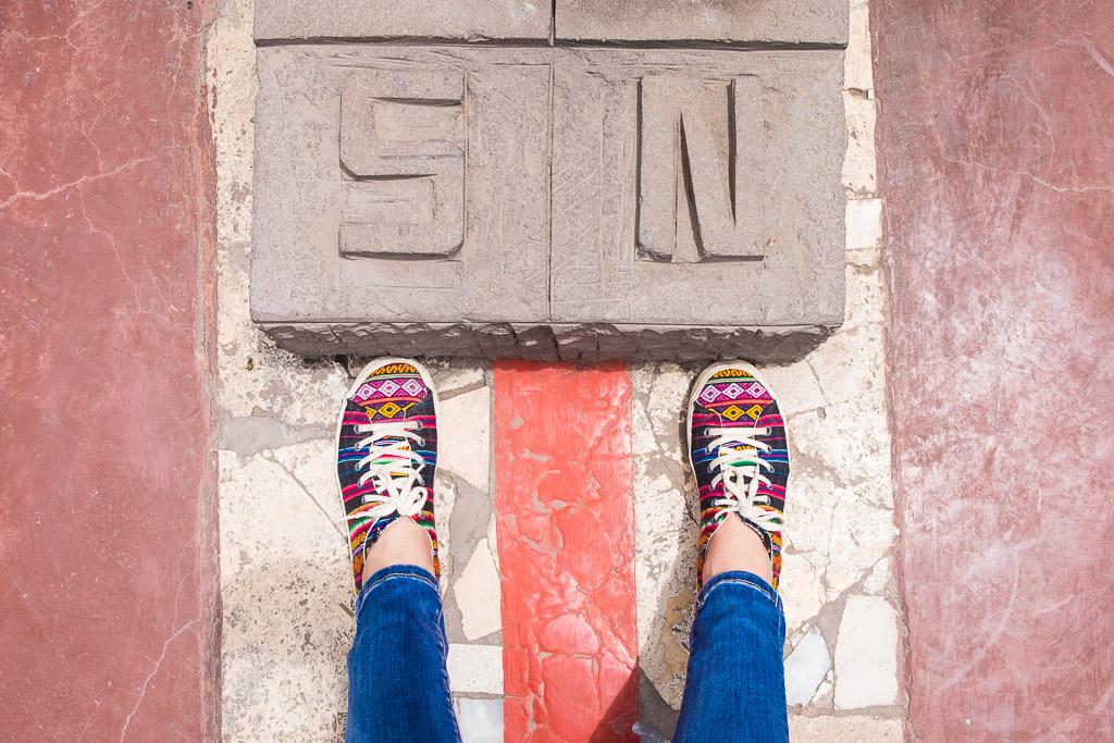 Ecuador vacation - straddling the Equator line.