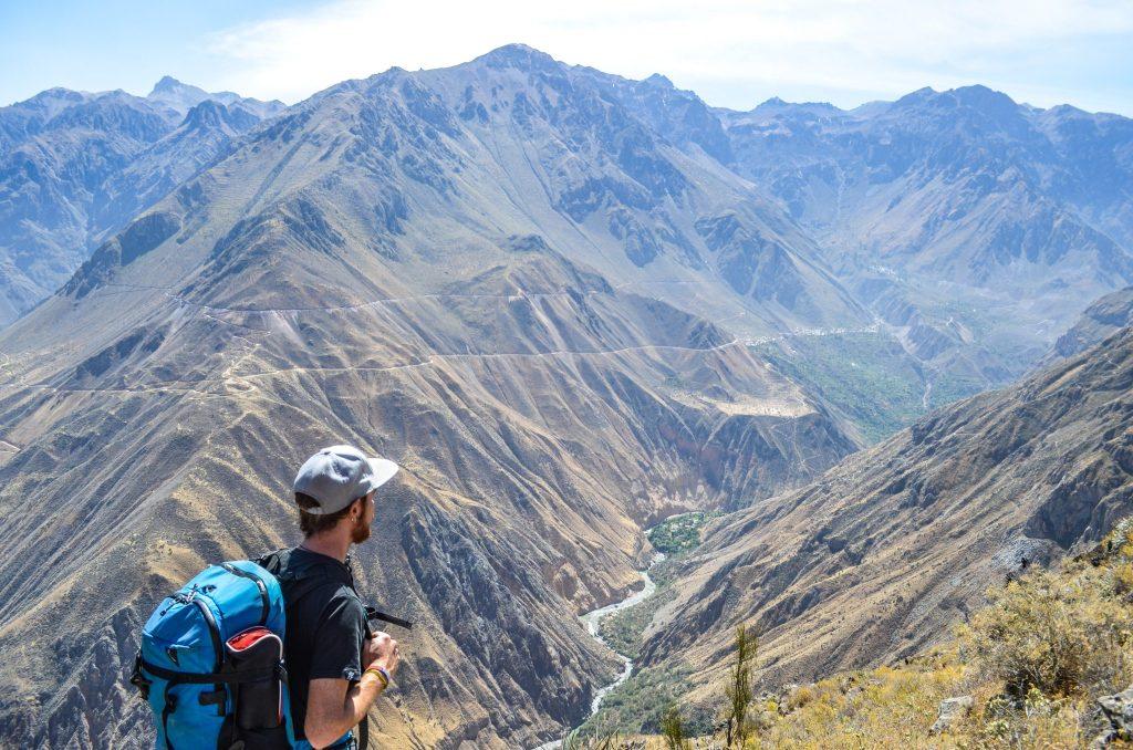 Colca Canyon trek - Trekker overlooking Colca Canyon.