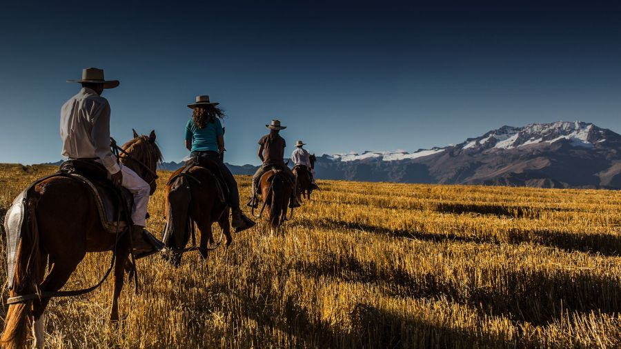 Things to do in Sacred Valley - Horseback riding past snow-capped mountains.