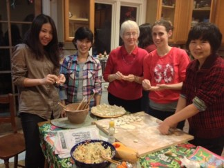 My daughter second from the RT of 3 nationalities of dumpling makers