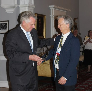 Governor-presenting-Jim-with-award.jpg