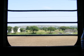 Window view of the countryside from train