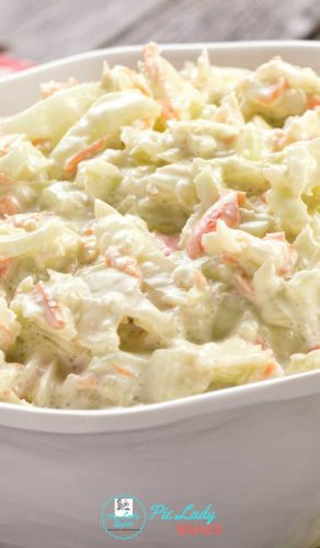 close up image of homemade coleslaw with onion and carrots