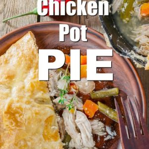 Chicken Pot Pie text over image of partly eaten pie in puff pastry with serving removed on a brown plate and brown fork