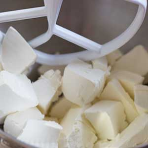 chunks of cream cheese in mixer
