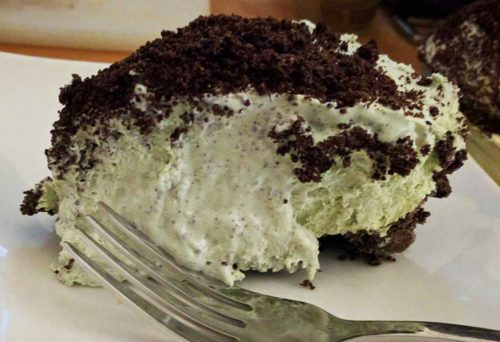 This scrumptiously super EASY no bake grasshopper pie is so light and fluffy – full of delicious Cool Whip, cream cheese, Oreos and Crème de Menthe! With a smooth minty chocolate-y taste, folks will ask for seconds. Think mint chocolate chip ice cream!