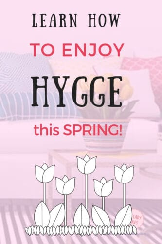learn how to enjoy hygge this spring with white tulips on a pink overlay with spring tulips in the background.