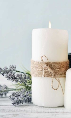 White candles, ties with jute and sprigs of lavender