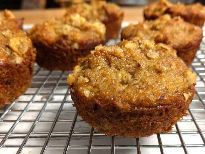 close up of banana walnut muffins on wire baking rack