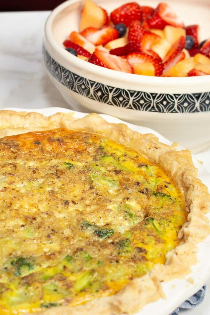 broccoli quiche recipe ready for brunch with fruit salad