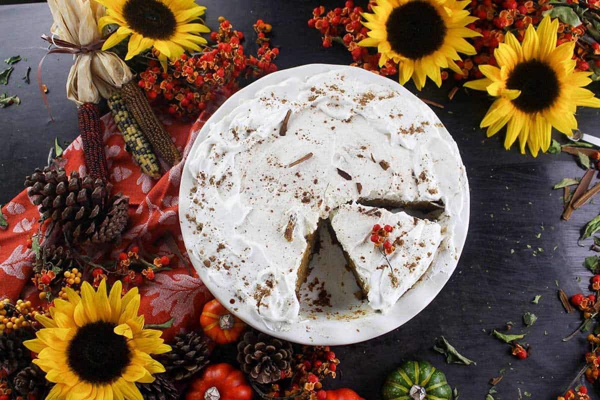 Full overhead shot of harvest flowers, pumpkins, kahlua pumpkin pie