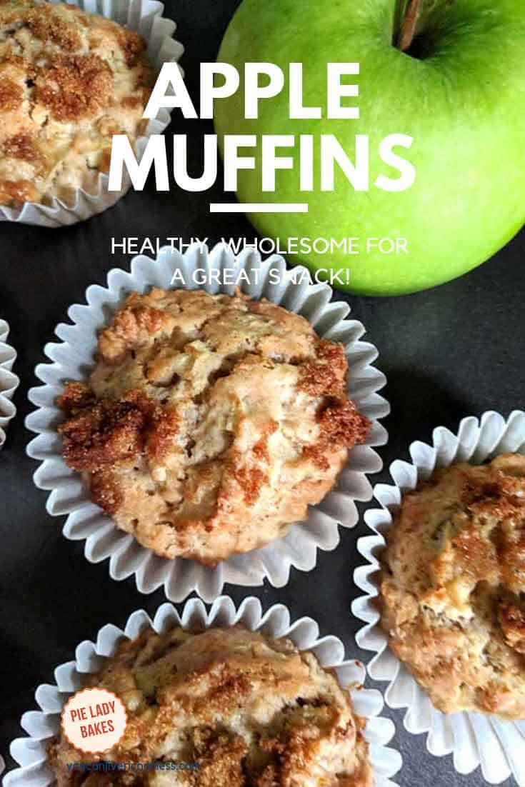 four apple muffins shown with granny smith apple