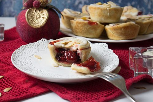 cranberry tart on white plate showing cranberry cherry filling
