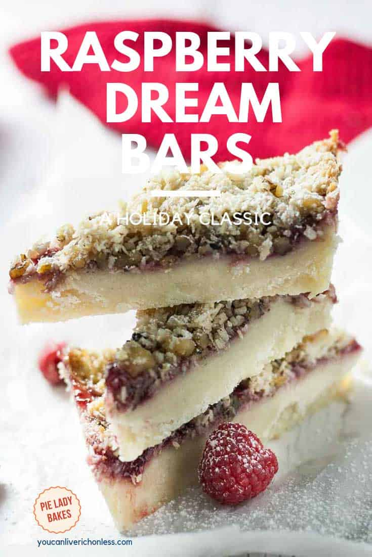three raspberry dream bars stacked with red napkin in background