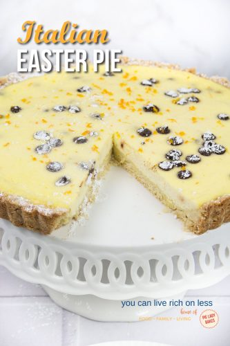 ricotta pie on white plate with scalloped edge with slice removed shows chocolate chips and orange zest Italian Easter Pie