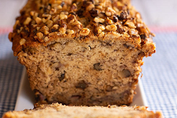 closeup of a loaf of banana nut bread that has been sliced