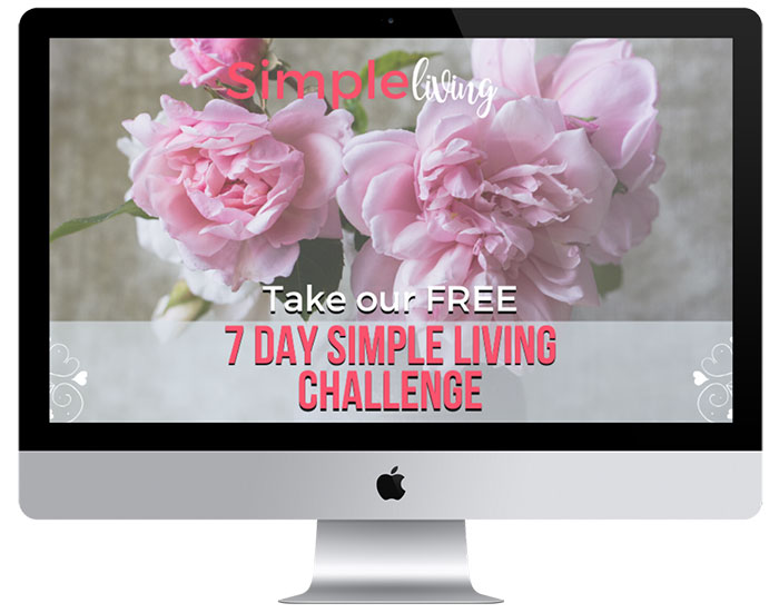 mac computer with 7 day simple living challenge and peonies in a vase in background