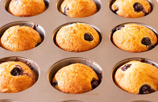 muffin tin with 9 blueberry muffins