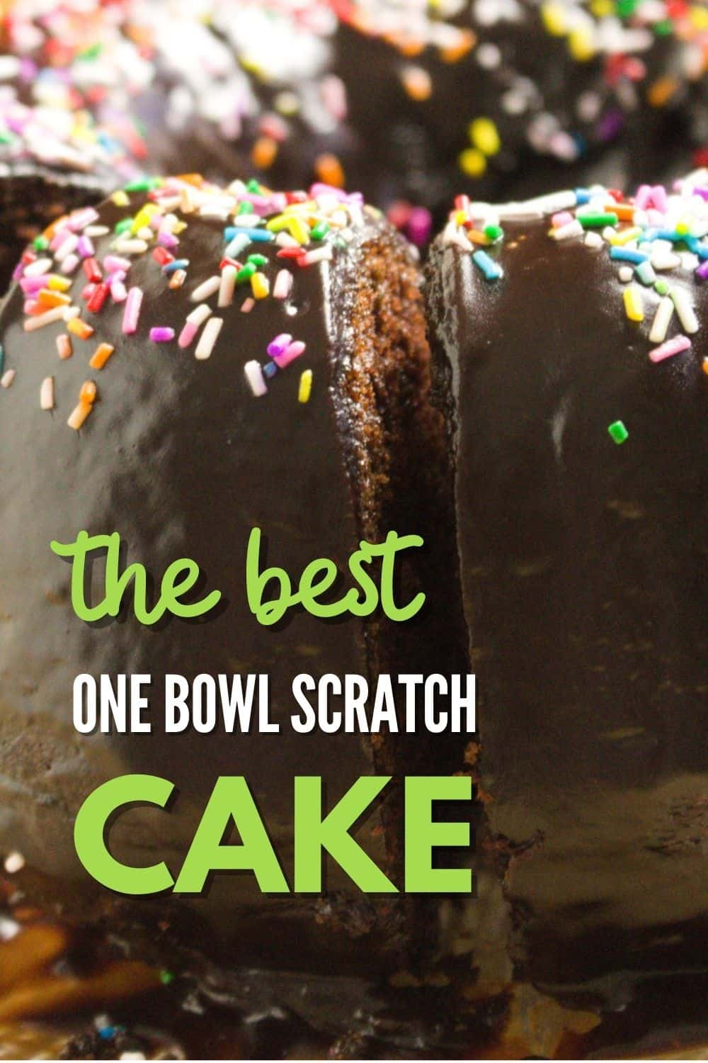 close up view of buttermilk chocolate pound cake with multi coloured sprinkles on top of chocolate icing.