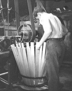 A coopersmith making a barrel for the oil industry.