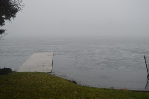 A private dock on Spanaway Lake still frozen solid as the rain begins.
